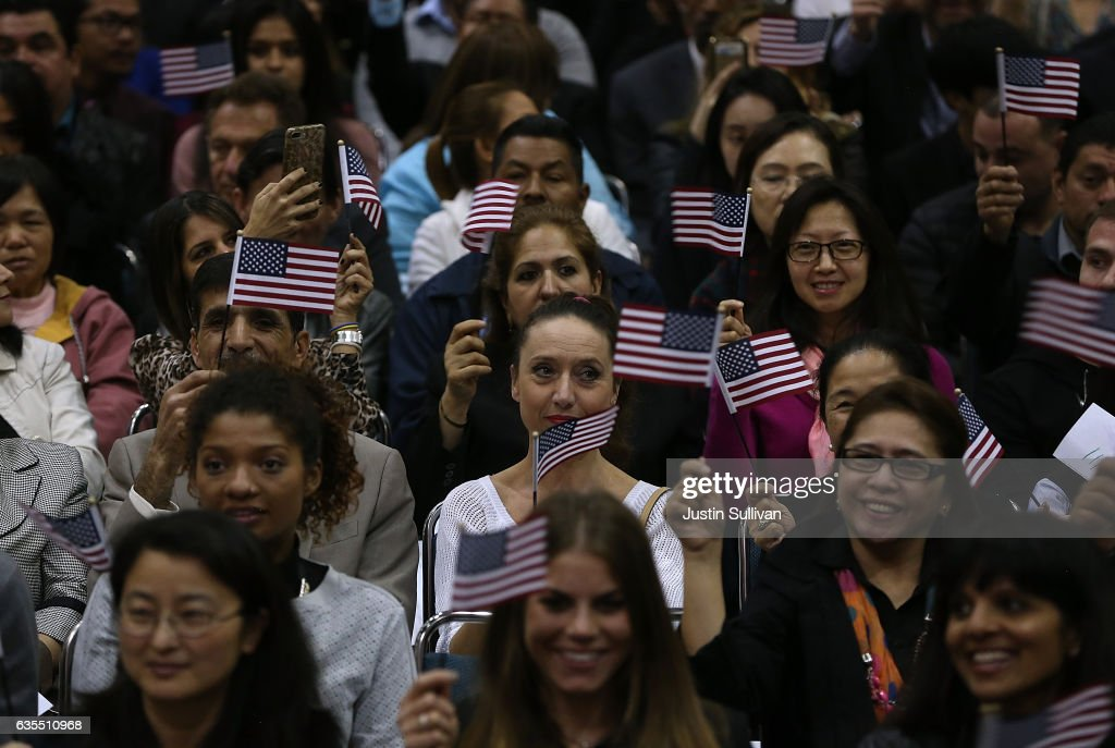 Newly sworn in U.S. citizens wave American flags during a naturalization ceremony held by U.S. Citizenship and Immigration Services at the Los Angeles Convention Center on February 15, 2017 in Los Angeles, California. 6,700 immigrants became U.S. citizens during two naturalization ceremonies held at the Los Angeles Convention Center.