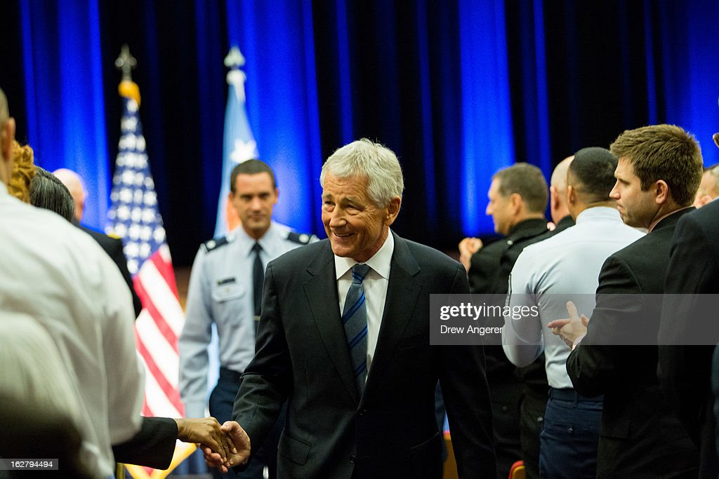 Newly sworn in U.S. Secretary of Defense <a gi-track='captionPersonalityLinkClicked' href=/galleries/search?phrase=Chuck+Hagel&family=editorial&specificpeople=504963 ng-click='$event.stopPropagation()'>Chuck Hagel</a> greets service members and employees of the Department of Defense during a daily staff meeting at the Pentagon February 27, 2013 in Arlington, Virginia. After a tumultuous confirmation hearing in the Senate, Hagel was sworn in during a small private ceremony on his first day at the Department of Defense.