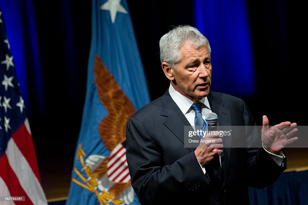 Newly sworn in U.S. Secretary of Defense Chuck Hagel speaks to service members and employees of the Department of Defense during a daily staff meeting at the Pentagon February 27, 2013 in Arlington, Virginia. After a tumultuous confirmation hearing in the Senate, Hagel was sworn in during a small private ceremony on his first day at the Department of Defense.