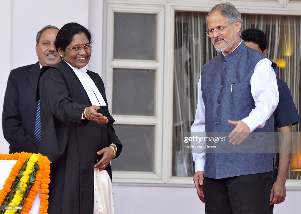 Newly sworn-in Chief Justice of the Delhi High Court Justice Gorla Rohini with Lieutenant Governor of Delhi Najeeb Jung (R) after taking oath at Raj Niwas, on April 21, 2014 in New Delhi, India. Justice Rohini, 58, who hails from Visakhapatnam succeeds Justice N V Ramana, who had vacated the position in February following his elevation to the Supreme Court.