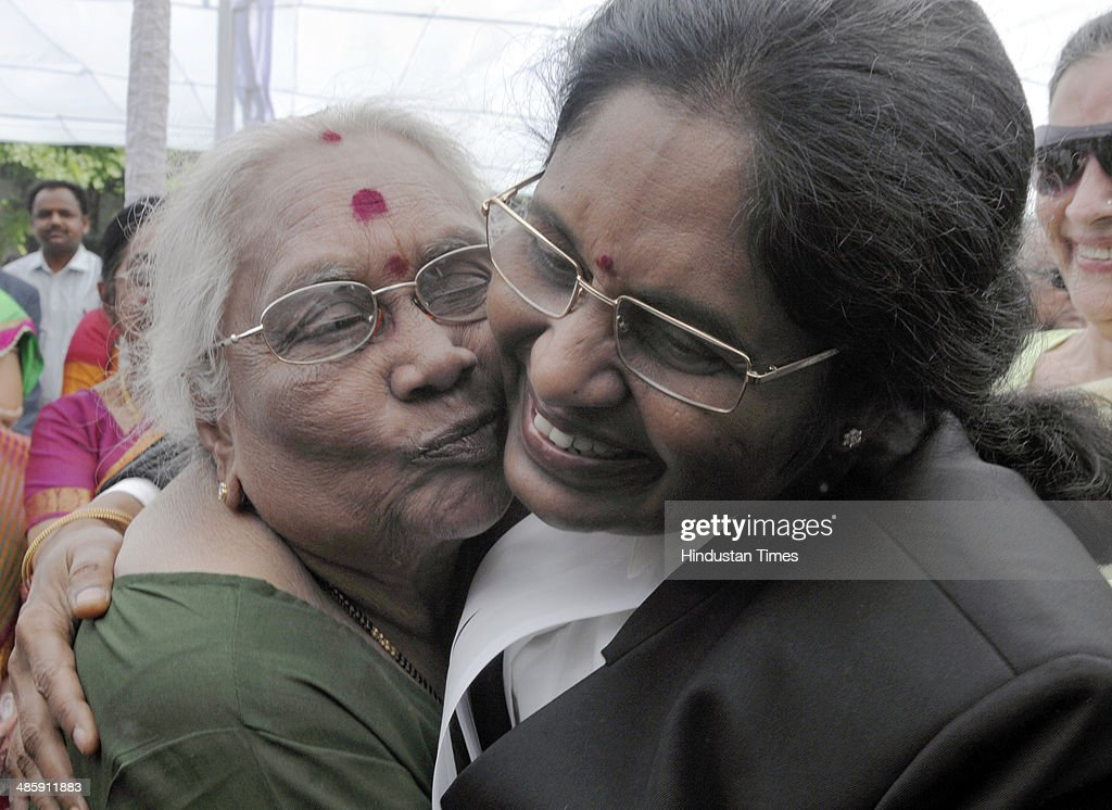 Newly sworn-in Chief Justice of the Delhi High Court Justice Gorla Rohini with her mother G Savitri after taking oath at Raj Niwas, on April 21, 2014 in New Delhi, India. Justice Rohini, 58, who hails from Visakhapatnam succeeds Justice N V Ramana, who had vacated the position in February following his elevation to the Supreme Court.