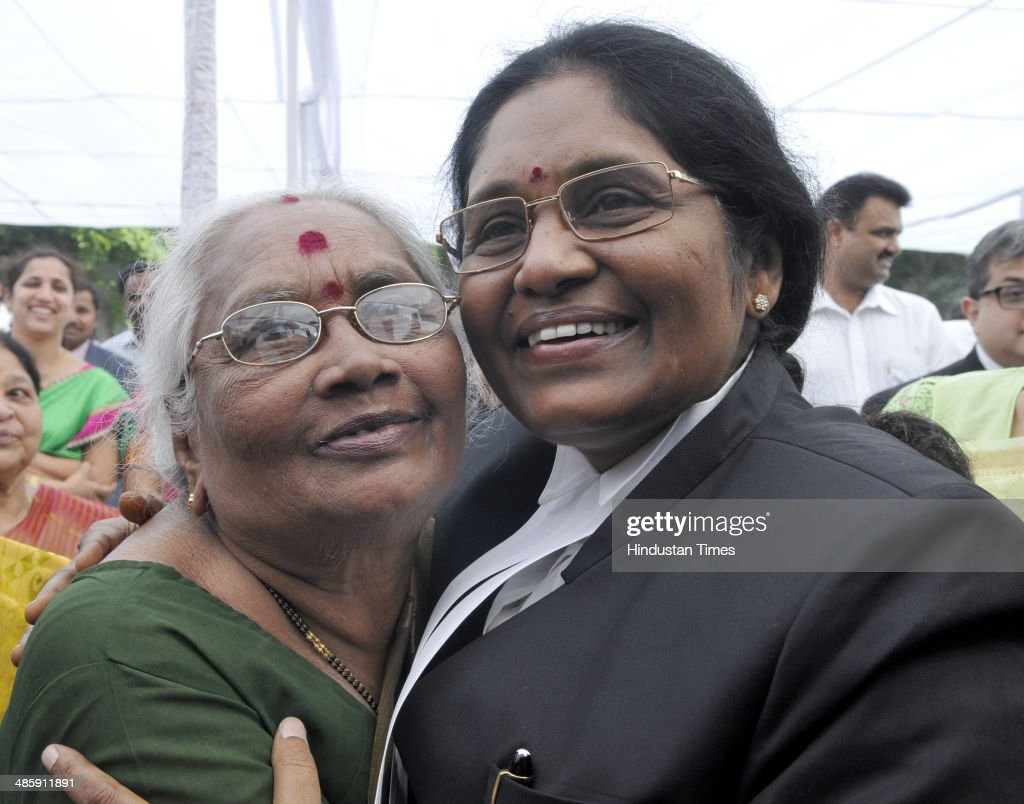 Newly sworn-in Chief Justice of the Delhi High Court Justice Gorla Rohini hugs her mother G Savitri after taking oath at Raj Niwas, on April 21, 2014 in New Delhi, India. Justice Rohini, 58, who hails from Visakhapatnam succeeds Justice N V Ramana, who had vacated the position in February following his elevation to the Supreme Court.