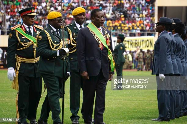 Newly swornin President Emmerson Mnangagwa followed by Army Chief of Staff General Constantino Chiwenga gestures during the Inauguration ceremony at...