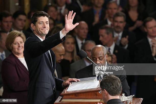 Newly swornin Speaker of the House Paul Ryan waves to colleagues after his election to the leadership position October 29 2015 in Washington DC The...