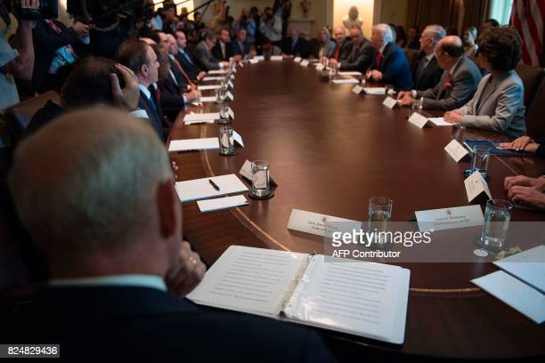 Newly swornin White House Chief of Staff John Kelly sits in on his first cabinet meeting at the White House in Washington DC on July 31 2017 John...