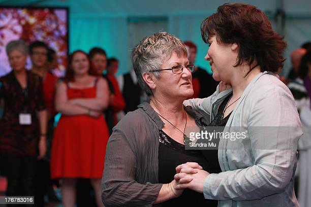 Newly wed couple Ally Wanikau and Lynley Bendall share their first dance during the reception inside the Air New Zealand hanger on August 19 2013 in...