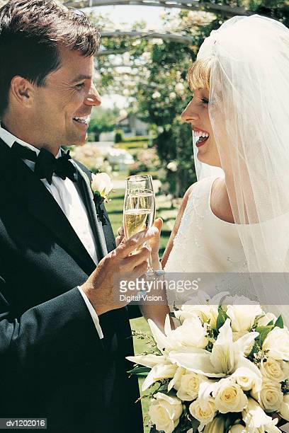 Newly Wed Couple Celebrating their Marriage With a Flute of Champagne