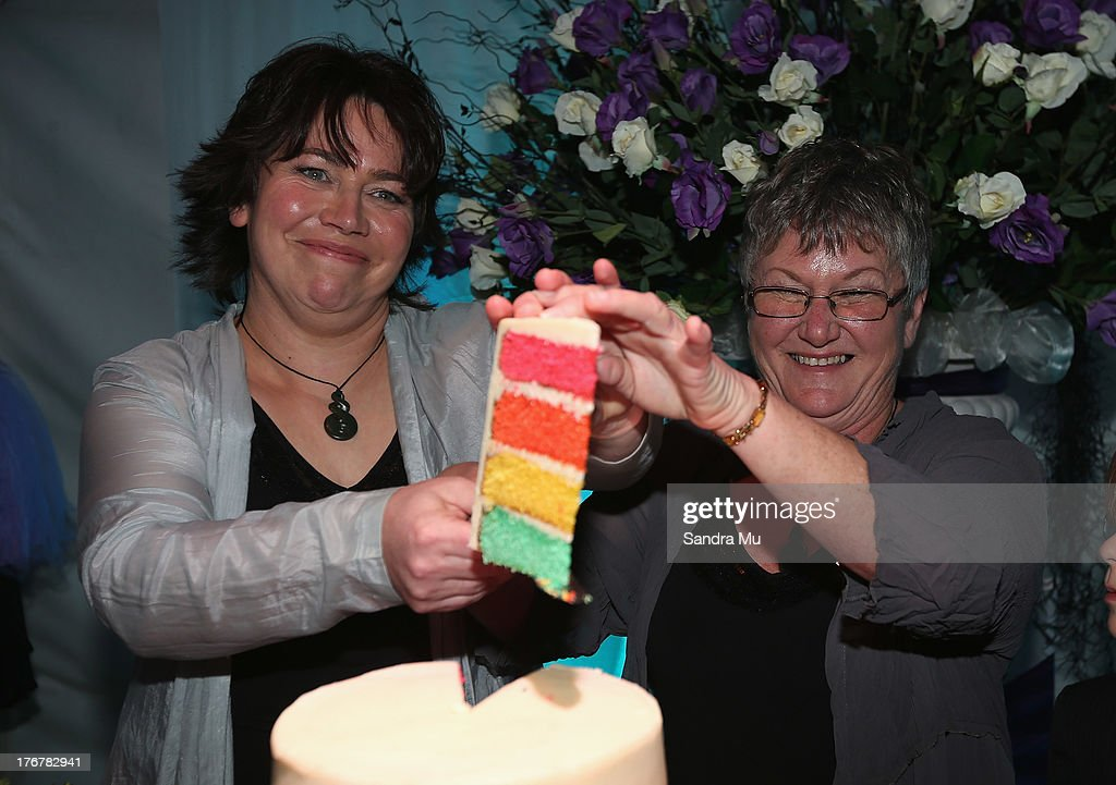 Newly wed couple Lynley Bendall (L) Ally Wanikau cut the cake during the reception inside the Air New Zealand hanger on August 19, 2013 in Auckland, New Zealand. New Zealand passed a bill to legalize same-sex marriage as of August 19, 2013. New Zealand is the first coutry in Oceania to leaglize same-sex marriage.