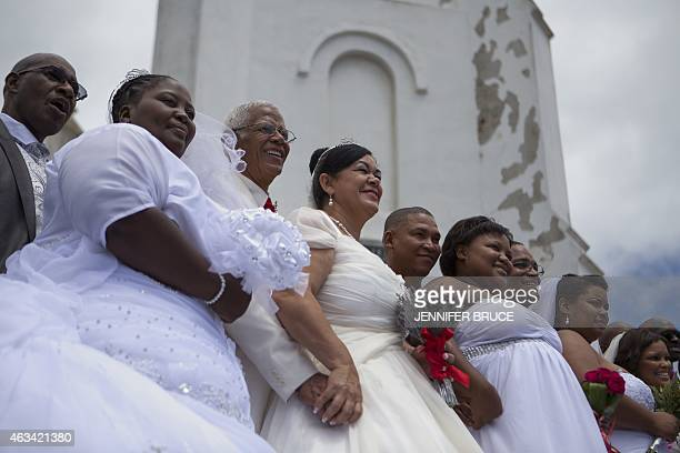 Newly wed couples pose outside the chapel after their wedding on Valentine's day at the South African world heritage site and former Apartheid prison...