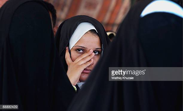 Newly wed Iraqis are seen during a group wedding celebration in alMuhsin Shiite mosque August 6 2005 in the Sadr city neighborhood in Baghdad Iraq...