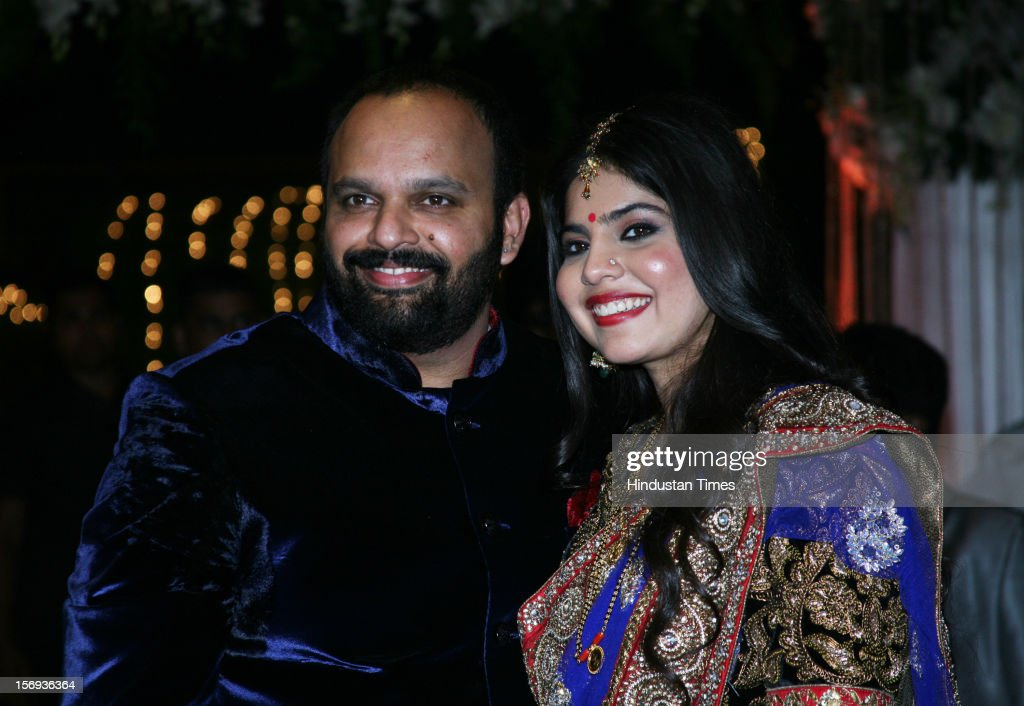 Newly wed pair of Rohit Shetty's sister Mehek with her groom Navin Shetty during her Wedding Reception at Sun & Sand, Juhu on November 11, 2012 in Mumbai, India.