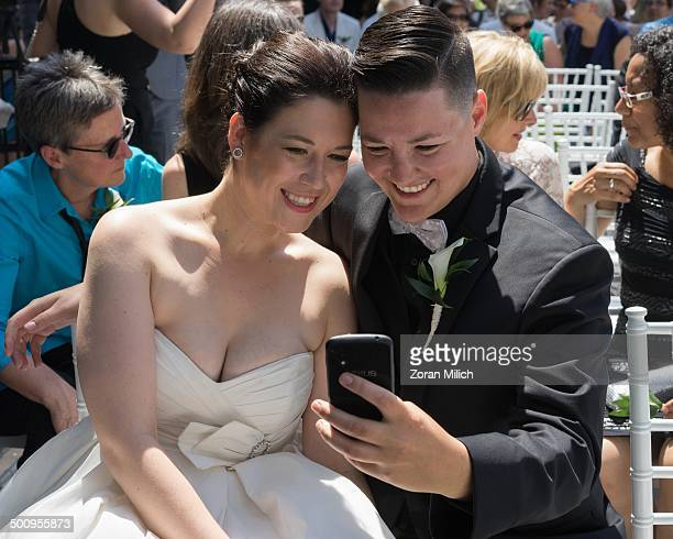 Newly wed same sex couple at mass samesex wedding ceremony at WorldPride 2014 an event that promotes lesbian gay bisexual and transgender issues...