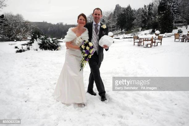 Newly weds Philip Cass and Natalie Britton from Bristol in the snow after their marriage at Tortworth Court Four Pillars Hotel at Tortworth South...