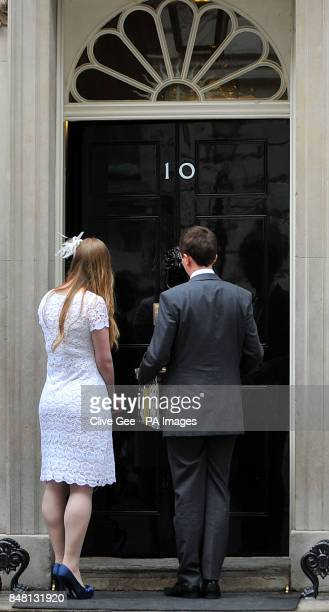 Newly weds Rhys and Esther Curnow hand over a box representing a petition for The Coalition for Marriage at 10 Downing Street London following the...