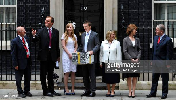 Newly weds Rhys and Esther Curnow hold a box representing a petition for The Coalition for Marriage with Jim Dobbin MP David Burrows MP Fiona Bruce...