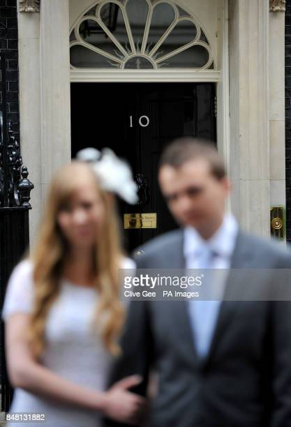 Newly weds Rhys and Esther Curnow outside no 10 Downing Street London after they handed over a box representing a petition for The Coalition for...