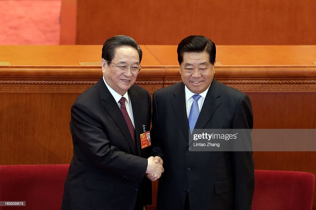 Newly-appointed Chairman of the Chinese People's Political Consultative Conference (CPPCC) Yu Zhengsheng (L) shakes hands with outgoing Chairman <a gi-track='captionPersonalityLinkClicked' href=/galleries/search?phrase=Jia+Qinglin&family=editorial&specificpeople=687988 ng-click='$event.stopPropagation()'>Jia Qinglin</a> (R) during a plenary session of the CPPCC held at the Great Hall of the People on March 11, 2013 in Beijing, China. The CPPCC is a patriotic united front organization of the Chinese people, serving as a key mechanism for multi-party cooperation and political consultation under the leadership of the Communist Party of China.