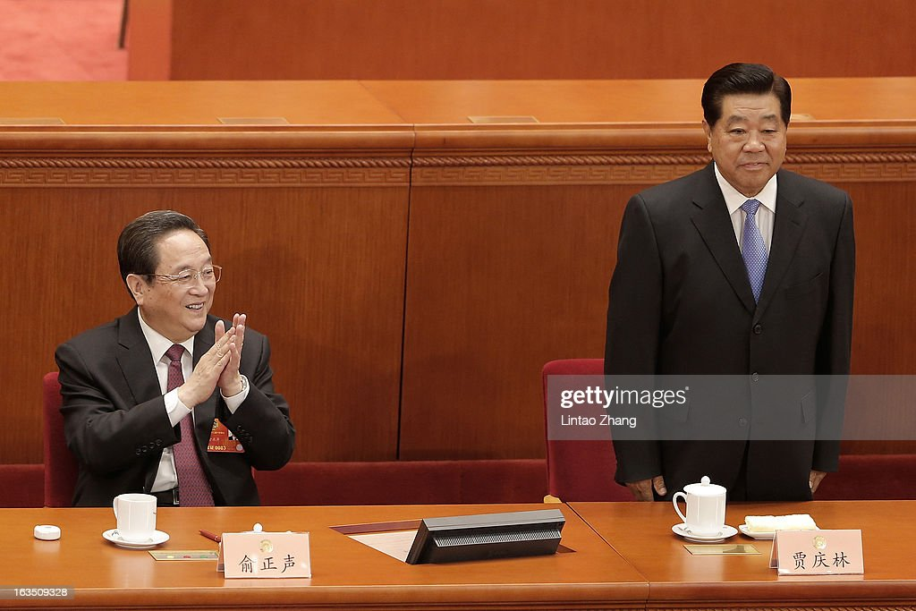 Newly-appointed Chairman of the Chinese People's Political Consultative Conference (CPPCC) Yu Zhengsheng (L) and outgoing Chairman <a gi-track='captionPersonalityLinkClicked' href=/galleries/search?phrase=Jia+Qinglin&family=editorial&specificpeople=687988 ng-click='$event.stopPropagation()'>Jia Qinglin</a> (R) attends the during a plenary session of the CPPCC held at the Great Hall of the People on March 11, 2013 in Beijing, China. Yu Zhengsheng was elected Chairman of the National Committee of CPPCC. The CPPCC is a patriotic united front organization of the Chinese people, serving as a key mechanism for multi-party cooperation and political consultation under the leadership of the Communist Party of China.