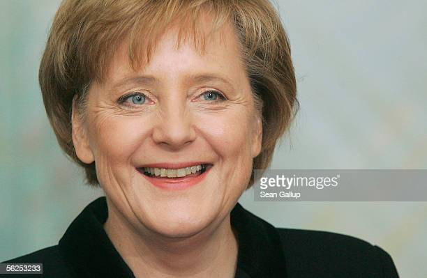 Newlyappointed German Chancellor Angela Merkel smiles after receiving her official document confirming her chancellorship from German President Horst...