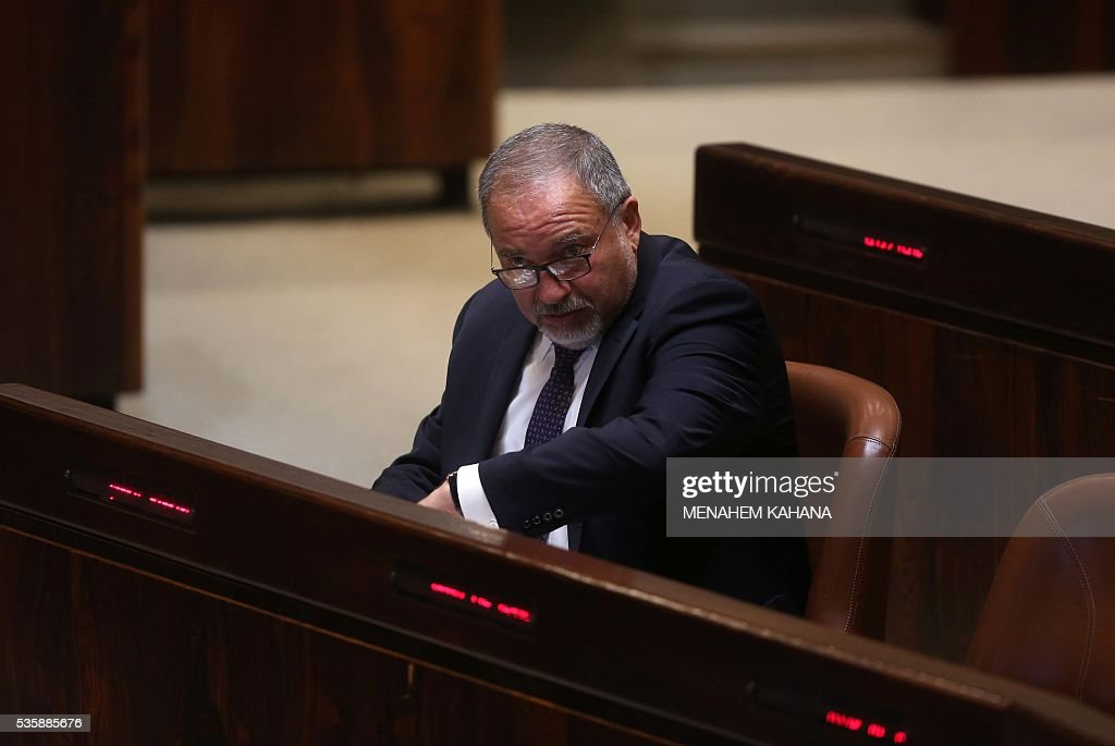 Former Israeli foreign minister and ultra-nationalist MP Avigdor Lieberman is seen during a session of the Israeli parliament in which MPs are debating whether to approve his appointment as defence minister, on May 30, 2016 in Jerusalem. Israeli Prime Minister Benjamin Netanyahu's cabinet voted to expand his coalition and appoint hardliner Avigdor Lieberman as defence minister, bringing weeks of political intrigue -- and outrage -- towards a close. Parliament was expected later today to approve the appointment of Lieberman, a former foreign minister and ultra-nationalist who has pledged harsh measures against Palestinian 'terrorists'. KAHANA