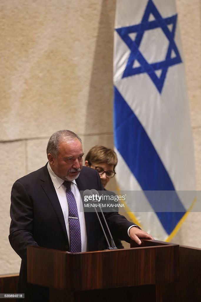 Newly-appointed Israeli Defence Minister Avigdor Lieberman, the head of hardline nationalist party Yisrael Beitenu, is sworn in during a Knesset (Israeli parliament) session on May 30, 2016, in Jerusalem. The Israeli parliament approved Lieberman as the country's new defence minister hours after Prime Minister Benjamin Netanyahu's cabinet endorsed him. Lieberman, who has pledged harsh measures against Palestinian 'terrorists', was approved by 55 members of the 120-seat Knesset while 43 voted against, one abstained and the others were absent. KAHANA