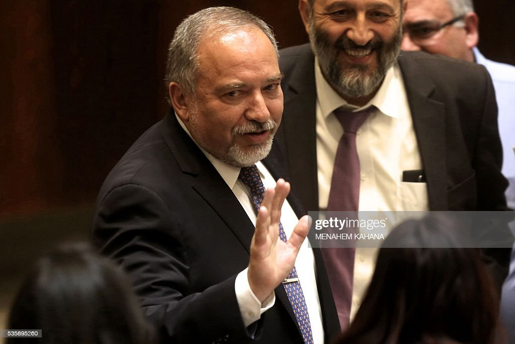 Newly-appointed Israeli Defence Minister Avigdor Lieberman waves during a Knesset (Israeli parliament) session in which he was sworn in, on May 30, 2016, in Jerusalem. Lieberman was sworn in as Israel's new defence minister after winning support in the cabinet and in parliament, ending weeks of political intrigue and outrage. Netanyahu's cabinet voted to expand his coalition and appoint Lieberman, before the 120-seat Knesset approved him by a vote of 55-43. KAHANA