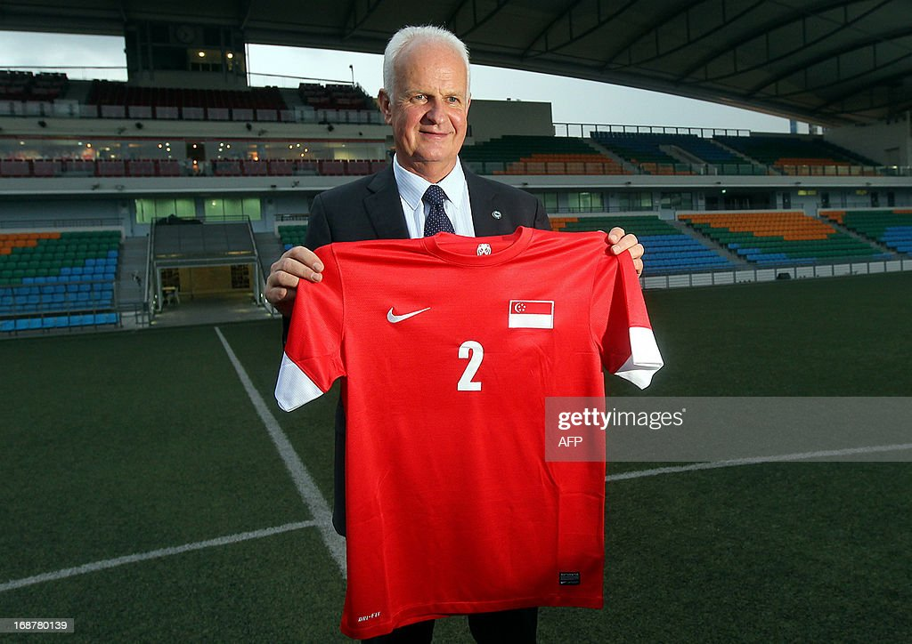 Newly-appointed Singaporean football national team coach Bernd Stange from Germany poses with the team jersey after a press conference in Singapore on May 15, 2013. Singapore's national football team on May 15 named Bernd Stange of Germany as head coach of the national team, replacing Serbian Radojko Avramovic, who led the city-state to three Southeast Asian championships.