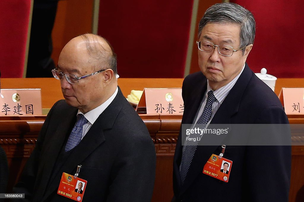 Newly-appointed Vice chairman of the Chinese People's Political Consultative Conference (CPPCC ) Chen Yuan (L) and <a gi-track='captionPersonalityLinkClicked' href=/galleries/search?phrase=Zhou+Xiaochuan&family=editorial&specificpeople=781144 ng-click='$event.stopPropagation()'>Zhou Xiaochuan</a> (R), Governor of the People's Bank of China, leave after the closing session of the annual CPPCC held at the Great Hall of the People on March 12, 2013 in Beijing, China. The newly-elected Chairman of the CPPCC Yu Zhengsheng pledged Tuesday that China will not copy Western political systems under any circumstances.