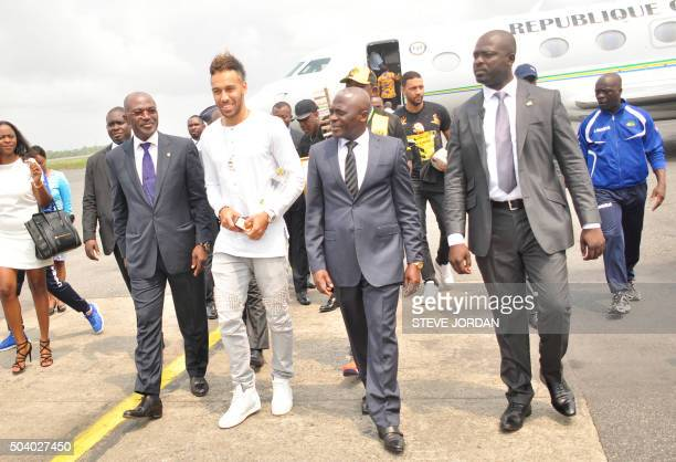 Newlycrowned African Player of the Year Borussia Dortmund football player PierreEmerick Aubameyang holding his trophy exits a plane after landing in...