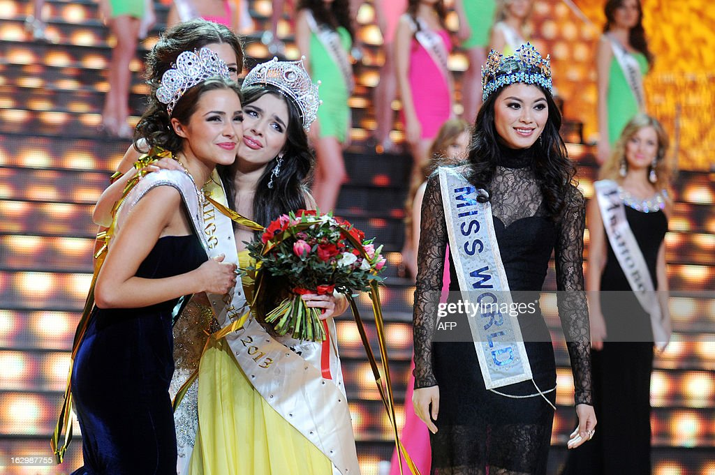 Newly-crowned Miss Russia 2013 Elmira Abdrazakova (3rd L) reacts on stage as current Miss World 2012 Yu Wenxia (R) of China looks on, during the competition in Moscow late on March 2, 2013. The 18-year-old Abdrazakova from Mezhdurechensk was crowned the 2013 winner in the 21st edition of Miss Russia.