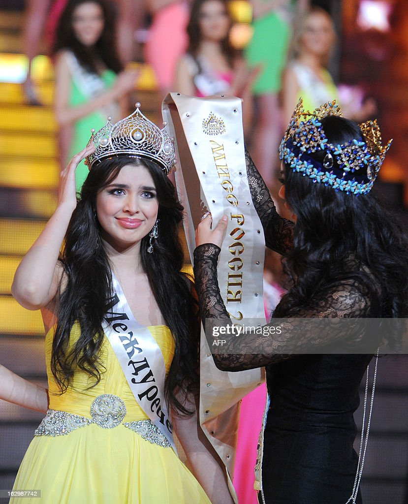 Newly-crowned Miss Russia 2013 Elmira Abdrazakova (L) receives her title from current Miss World 2012 Yu Wenxia (R) of China during the competition in Moscow late on March 2, 2013. The 18-year-old Abdrazakova from Mezhdurechensk was crowned the 2013 winner in the 21st edition of Miss Russia.