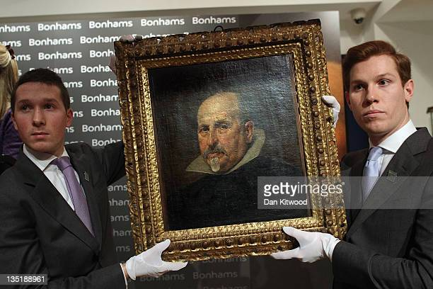 A newlydiscovered painting by Spanish artist Diego Rodriguez de Silva y Velazquez is held up for display as it goes under the hammer at the Old...