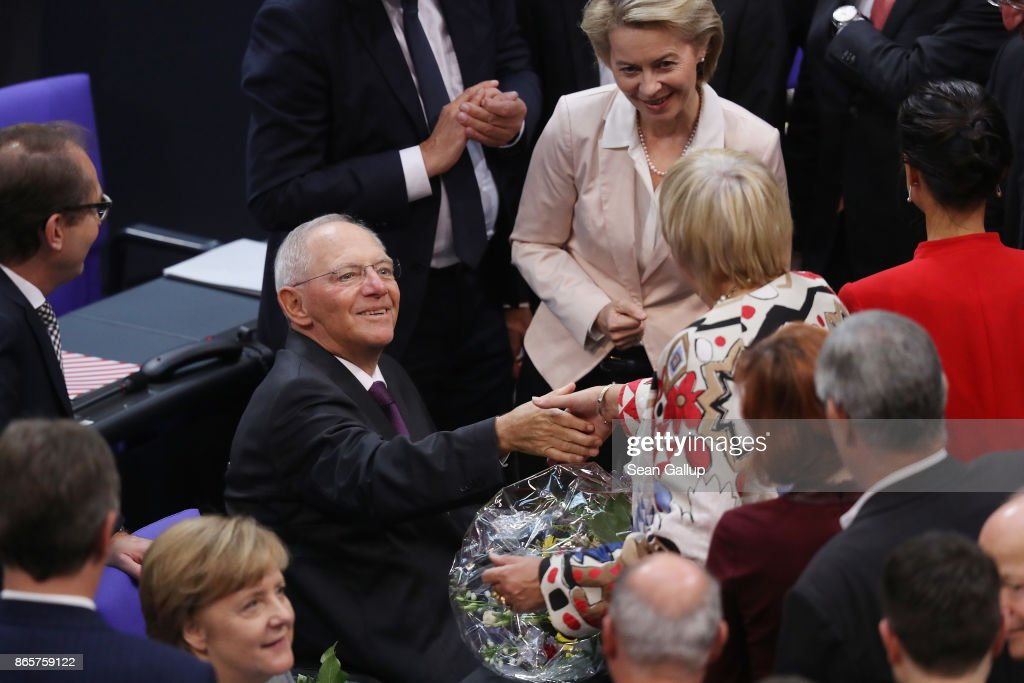 Newly-elected Bundestag President Wolfgang Schaeuble (L) receives the congratulations of parliamentarians shortly after he was elected at the opening session of the new Bundestag on October 24, 2017 in Berlin, Germany. Today's is the first session since German federal elections in September. The new Bundestag is markedly different from the previous one, as instead of four parties the new parliament contains six, including approximately 90 parliamentarians of the right-wing Alternative for Germany (AfD). Meanwhile the German Christian Democrats (CDU/CSU), the Free Democratic Party (FDP) and the German Greens Party (Buendnis 90/Die Gruenen) are continuing their negotiations for forming a government coalition.