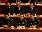 Newlyelected Chinese Defense Minister Chang Wanquan looks on during the election of the new vice premiers foreign and defense ministers of China...
