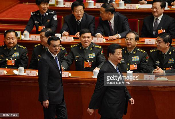 Newlyelected Chinese Premier Li Keqiang and President Xi Jinping walk past military delegates including new Defense Minister Chang Wanquan during the...