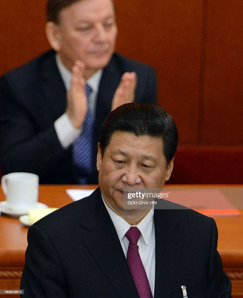 Newly-elected Chinese President Xi Jinping (front) delivers his maiden speech at the closing session of the National People's Congress (NPC) at the Great Hall of the People in Beijing on March 17, 2013. Xi Jinping told the country's military to improve its ability to 'win battles' in his first speech as head of state, as Beijing is embroiled in a bitter territorial row with Japan. AFP PHOTO / GOH CHAI HIN