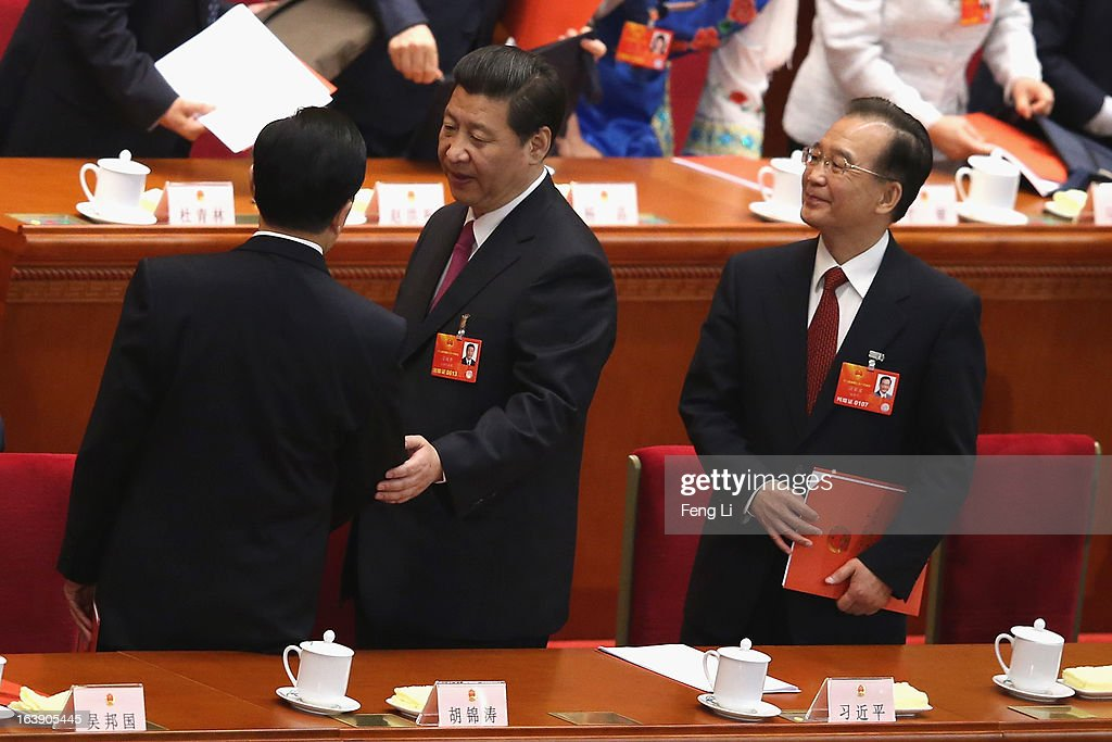 Newly-elected Chinese President Xi Jinping (C) talks with former Chinese president Hu Jintao (L) as former Chinese Premier Wen Jiabao (R) looks on after the closing session of the National People's Congress (NPC) at the Great Hall of the People on March 17, 2013 in Beijing, China. China's newly-elected president Xi Jinping pledged Sunday to resolutely fight against corruption and other misconduct in all manifestations.