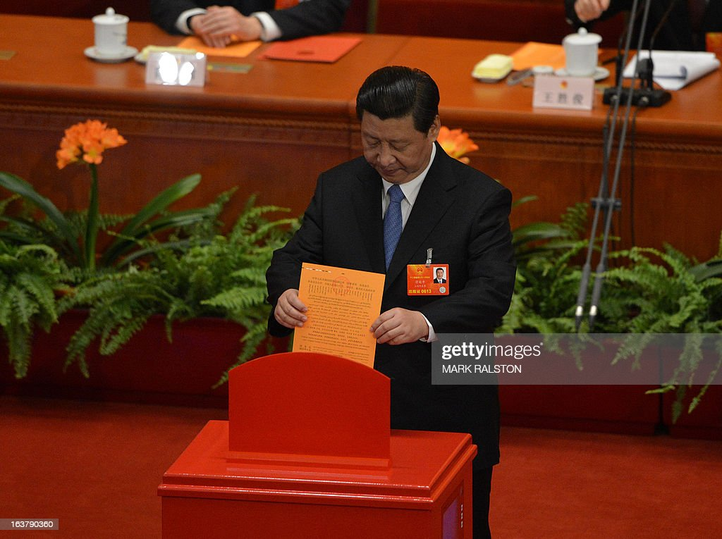 Newly-elected Chinese President Xi Jinping votes during the election of the new vice premiers, foreign and defense ministers of China during the 12th National People's Congress (NPC) in the Great Hall of the People in Beijing on March 16, 2013. China's parliament named Xi Jinping as president on March 15 four months after he took charge of the Communist Party with pledges of reform that have raised hopes but so far yielded little change. AFP PHOTO / Mark RALSTON