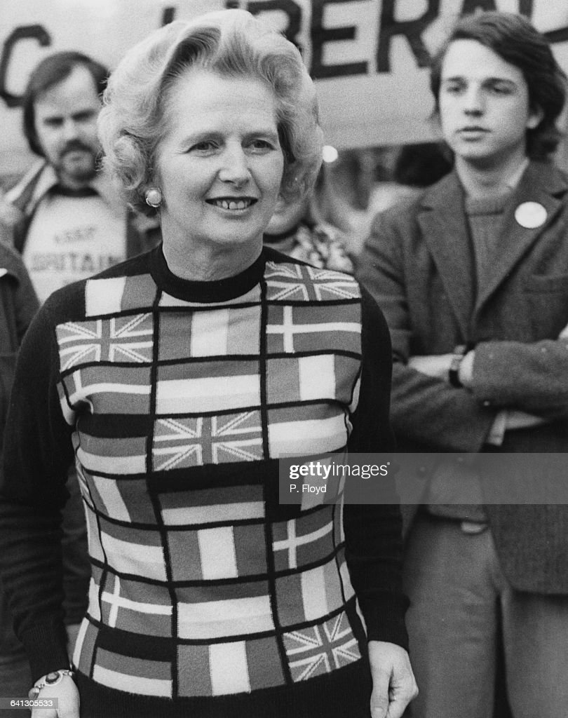 Newly-elected Conservative Party Leader of the Opposition, <a gi-track='captionPersonalityLinkClicked' href=/galleries/search?phrase=Margaret+Thatcher&family=editorial&specificpeople=159677 ng-click='$event.stopPropagation()'>Margaret Thatcher</a> (1925 - 2013) lends her support to 'Keep Britain in Europe' campaigners in Parliament Square, London, on 4th June 1975, the day before voting in the United Kingdom EEC referendum (or Common Market referendum). Thatcher is wearing a sweater featuring the flags of European member states. Britain had joined the European Community two years earlier and the following day, just over two-thirds of voters backed continued British membership.
