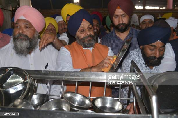 Newlyelected Delhi Sikh Gurdwara Management Committee president Manjit Singh GK along with DSGMC members washes utensils at Langar Hall at the Sikh...