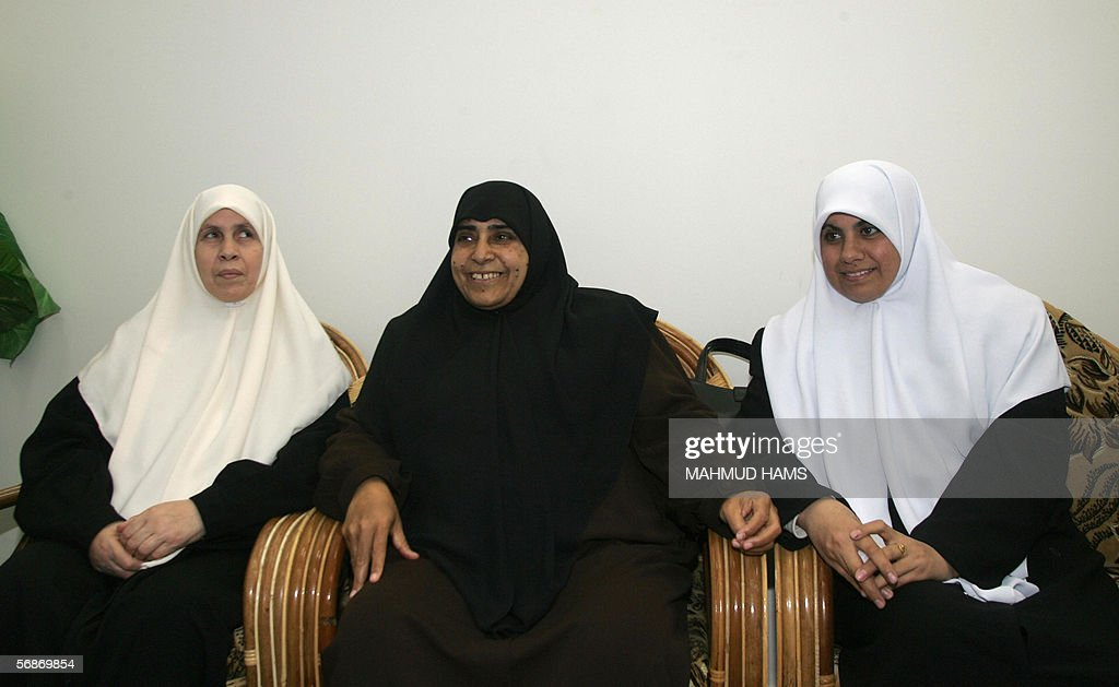 Newly-elected deputies of the Islamist movement Hamas (from L to R) Mariam Farhat, Jamila Al-Shanti, and Huda Naim meet to prepare for the first session of the new Palestinian Legislative Council (PLC) at the home of Hamas leader Ismail Haniyeh in the al-Shatti refugee camp in Gaza City, 17 February 2006. The Hamas-dominated parliament will be sworn in Saturday by Palestinian Authority president Mahmud Abbas. After the swearing in of the new parliament Abbas is to hand responsibility for forming a new government to a new prime minister chosen by Hamas.