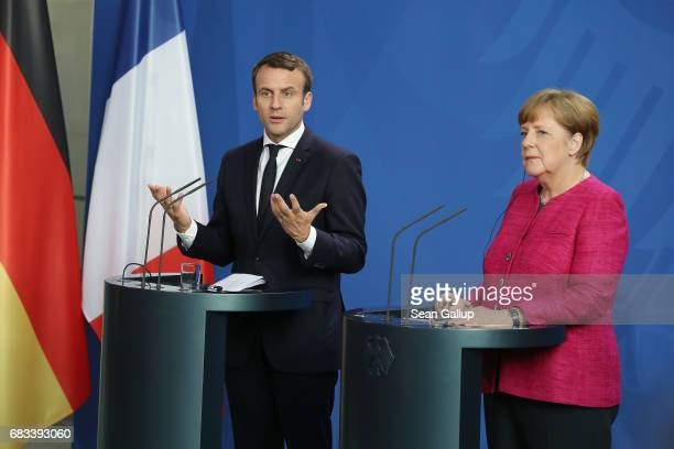 Newlyelected French President Emmanuel Macron and German Chancellor Angela Merkel speak to the media following talks at the Chancellery on May 15...