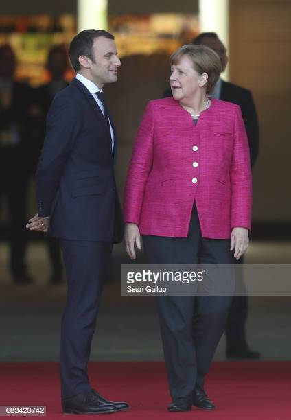 Newlyelected French President Emmanuel Macron and German Chancellor Angela Merkel chat upon Macron's arrival at the Chancellery on May 15 2017 in...