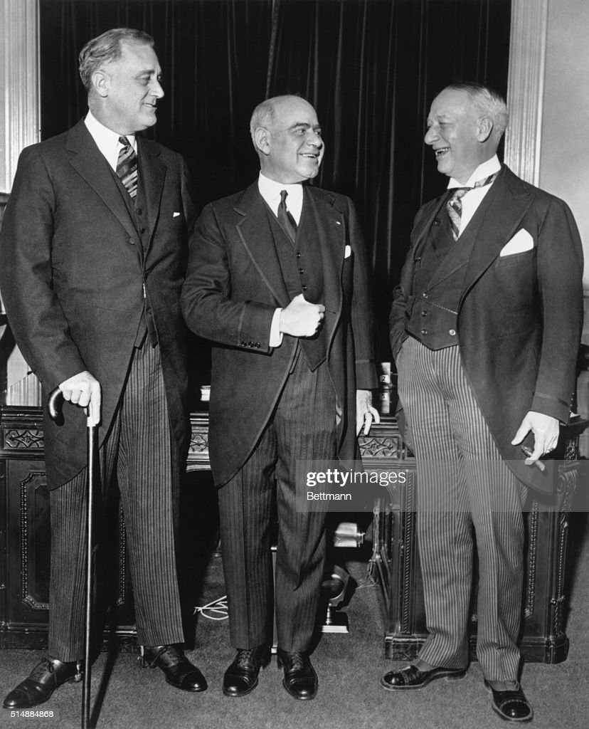 Newly-elected governor of New York Franklin Delano Roosevelt stands with his lieutenant governor, Herbert Lehman and the state's previous governor, Al Smith.