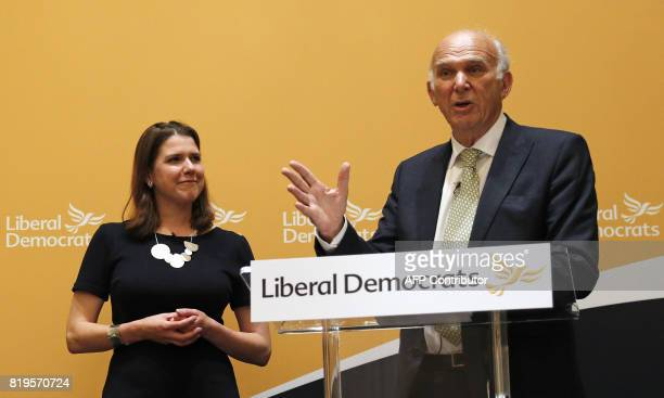 Newlyelected leader of the Liberal Democrats Sir Vince Cable addresses a press conference to announce his leadership as deputy leader Jo Swinson...