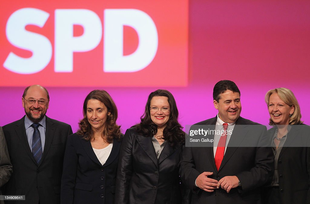 Newly-elected leaders of the German Social Democrats (SPD), including (from L to R), European Parliament representative Martin Schulz, co-Deputy Chairwoman Aydan Ozoguz, General Secretary <a gi-track='captionPersonalityLinkClicked' href=/galleries/search?phrase=Andrea+Nahles&family=editorial&specificpeople=822618 ng-click='$event.stopPropagation()'>Andrea Nahles</a>, Chairman <a gi-track='captionPersonalityLinkClicked' href=/galleries/search?phrase=Sigmar+Gabriel&family=editorial&specificpeople=543927 ng-click='$event.stopPropagation()'>Sigmar Gabriel</a> and co-Deputy Chairwoman <a gi-track='captionPersonalityLinkClicked' href=/galleries/search?phrase=Hannelore+Kraft&family=editorial&specificpeople=4643983 ng-click='$event.stopPropagation()'>Hannelore Kraft</a> pose shortly after their election on the second day of the SPD annual federal congress on December 5, 2011 in Berlin, Germany. The SPD is Germany's biggest opposition party and has seen its popularity rise in the last year as the current German government coalition of Christian Democrats and Free Democrats has faced political stumbling blocks.