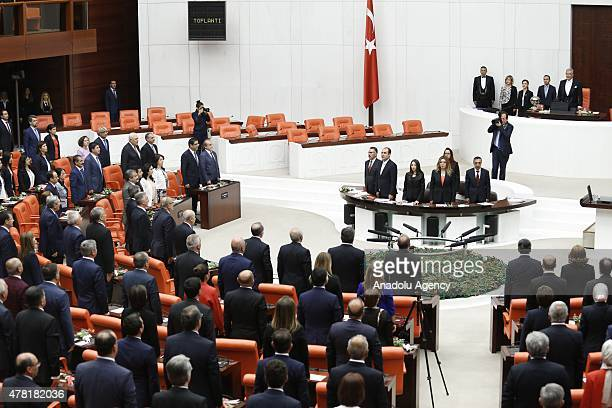 Newlyelected members of Turkish parliament stand in silence at the Grand National Assembly of Turkey ahead of the Turkish parliament's 25th term...
