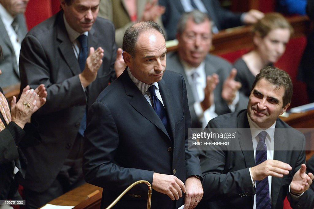 Newly-elected president of the right-wing UMP opposition party, Jean-Francois Cope is applauded as he arrives to speak during the weekly session of questions at the National Assembly on November 20, 2012 in Paris. AFP PHOTO ERIC FEFERBERG
