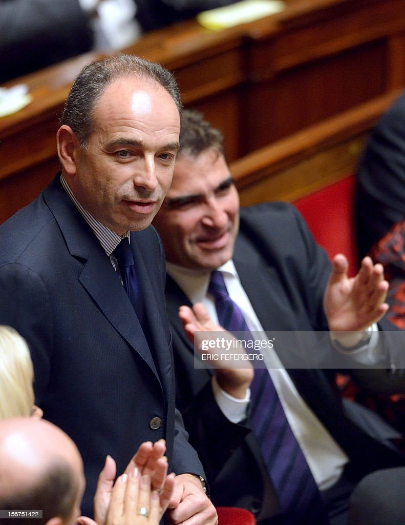 Newly-elected president of the right-wing UMP opposition party, Jean-Francois Cope is applauded during the weekly session of questions at the National Assembly on November 20, 2012 in Paris. AFP PHOTO ERIC FEFERBERG