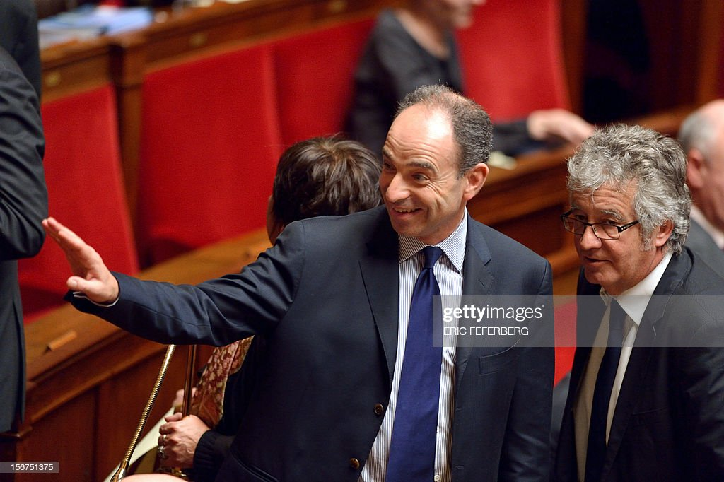 Newly-elected president of the right-wing UMP opposition party, Jean-Francois Cope greets MPs during the weekly session of questions at the National Assembly on November 20, 2012 in Paris.